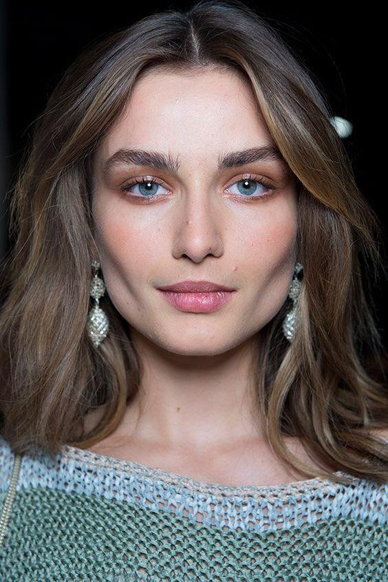 """**Mocha Makeup** <br><br> At Moschino, Tom Pecheux used Ground Brown Eye Shadow to create a subtle, more low-key approach to the smokey eye, in his bid to create faces inspired by """"60s high-society Irving Penn""""."""