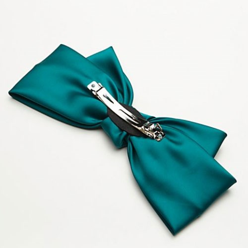 "Silk Bow Barrette, $23.40 at [Free People](https://www.freepeople.com/shop/silk-bow-barrette/|target=""_blank"")."