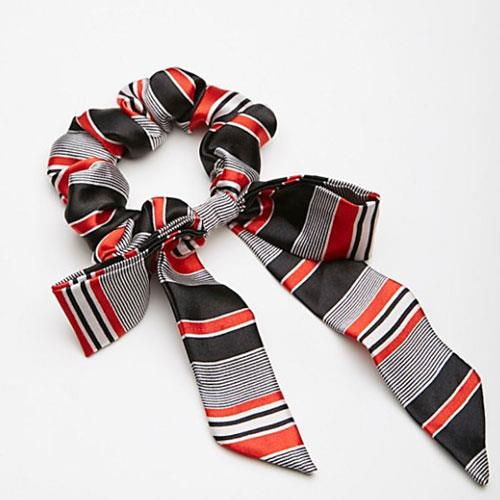 """Bow Scrunchie, $7.80 at [Free People](https://www.freepeople.com/shop/bow-scrunchie/?category=hair-beauty&color=060
