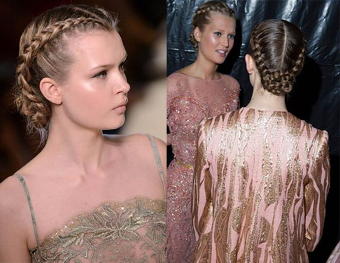 Braided beauties: At Elie Saab Hairstylist Orlando Pita centre-parted hair before braiding and coiling into low buns.