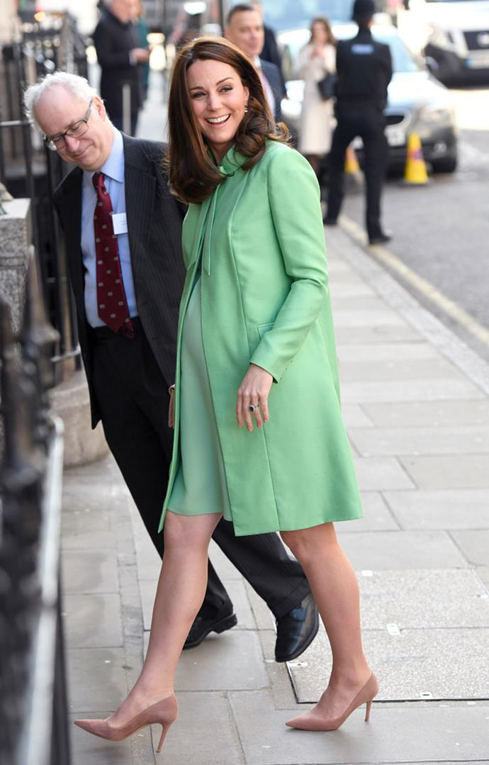 March 21 2018 - In a jade green overcoat with a matching shift dress at the Royal Society of Medicine in London.