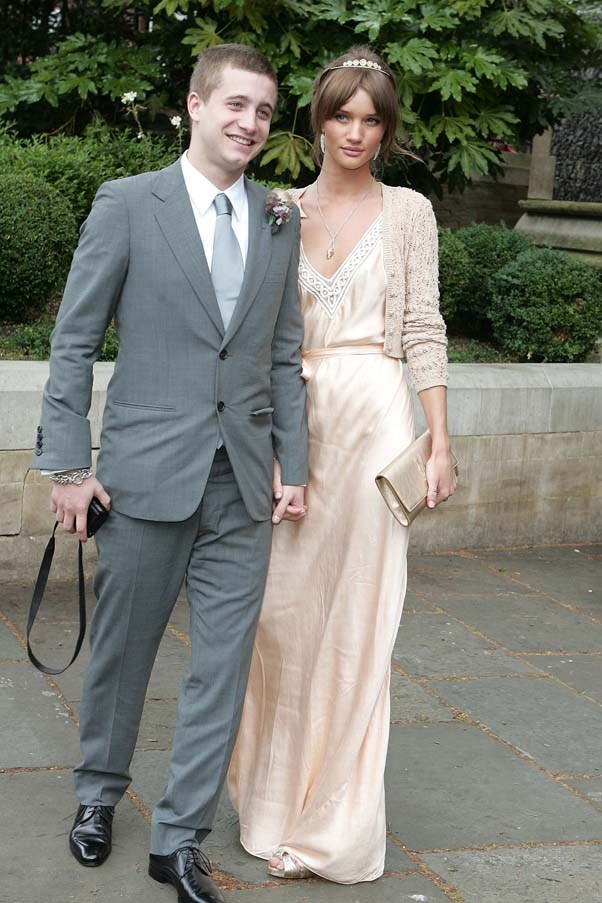 Tyrone Wood and Rosie Huntington-Whiteley at the wedding of Leah Wood and Jack Macdonald