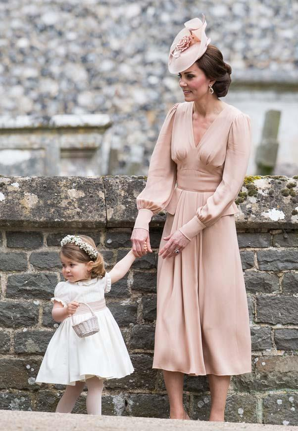 Kate Middleton in Alexander McQueen and Princess Charlotte at the wedding of Pippa Middleton