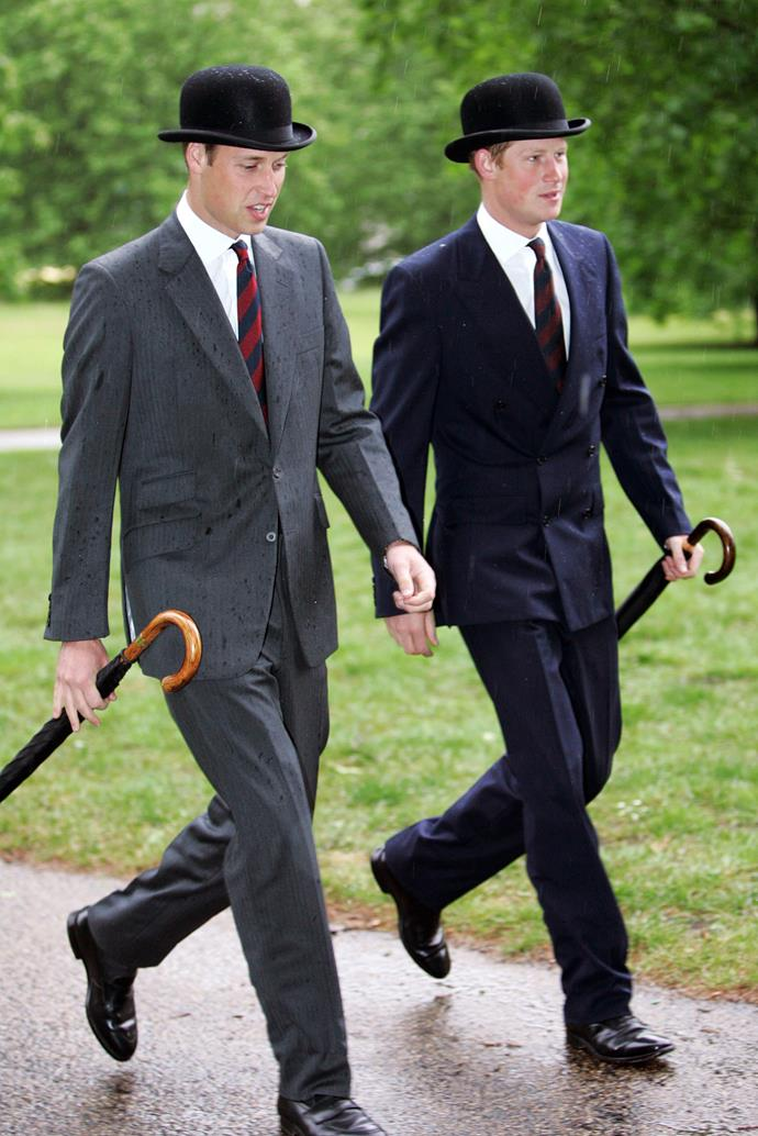 Princes William and Harry wearing lounge suits (and bowler hats).