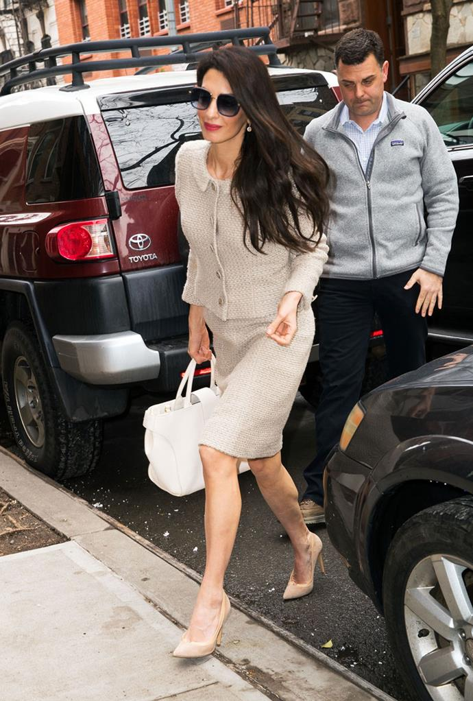 Amal has mastered corporate chic, with the new mum opting for a stone-coloured skirt suit complete with matching pumps while running errands in New York City.