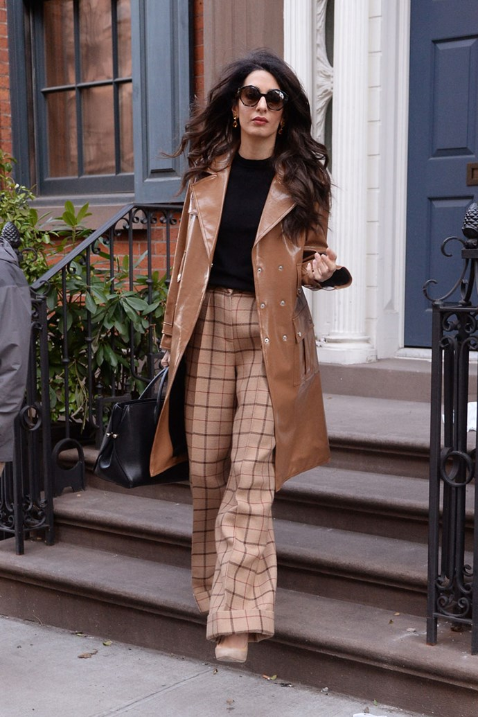 "Amal Clooney stepped out in New York City wearing two of [2018's top trends](https://www.harpersbazaar.com.au/fashion/fashion-trends-2018-16167|target=""_blank""): a caramel [vinyl trench](https://www.harpersbazaar.com.au/fashion/coat-trends-2018-16175
