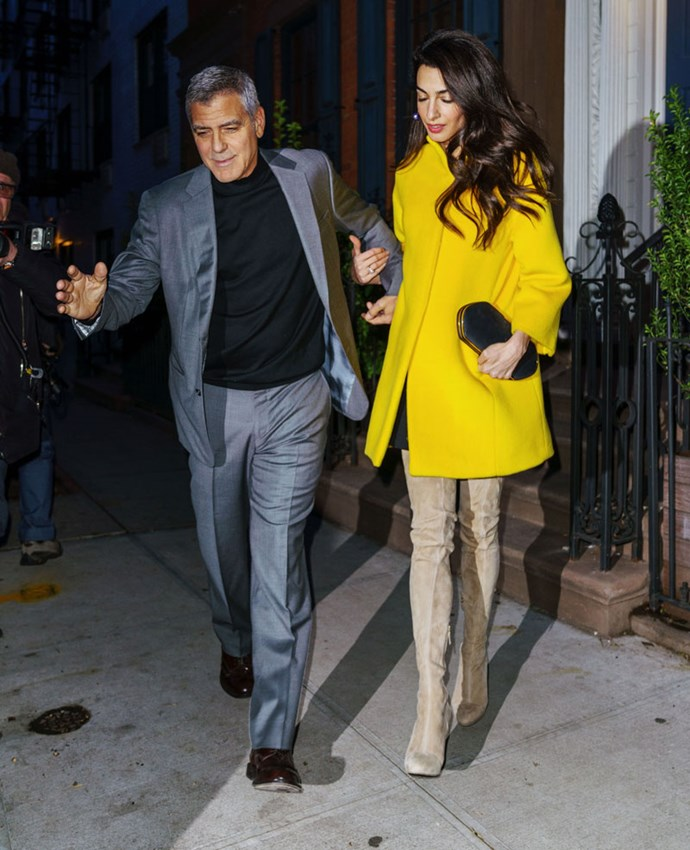 Just wow. Amal's having a major fashion moment right now. Her latest look? A marigold coat paired with thigh-high caramel suede boots.