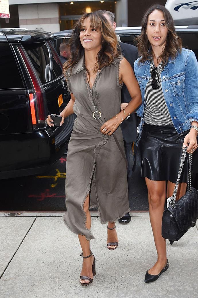 **Halle Berry**, *53* <br><br> Over the years, Halle Berry has worn numerous eye-catching ensembles, from sheer dresses to extravagant gowns, cementing her as a fashion queen.