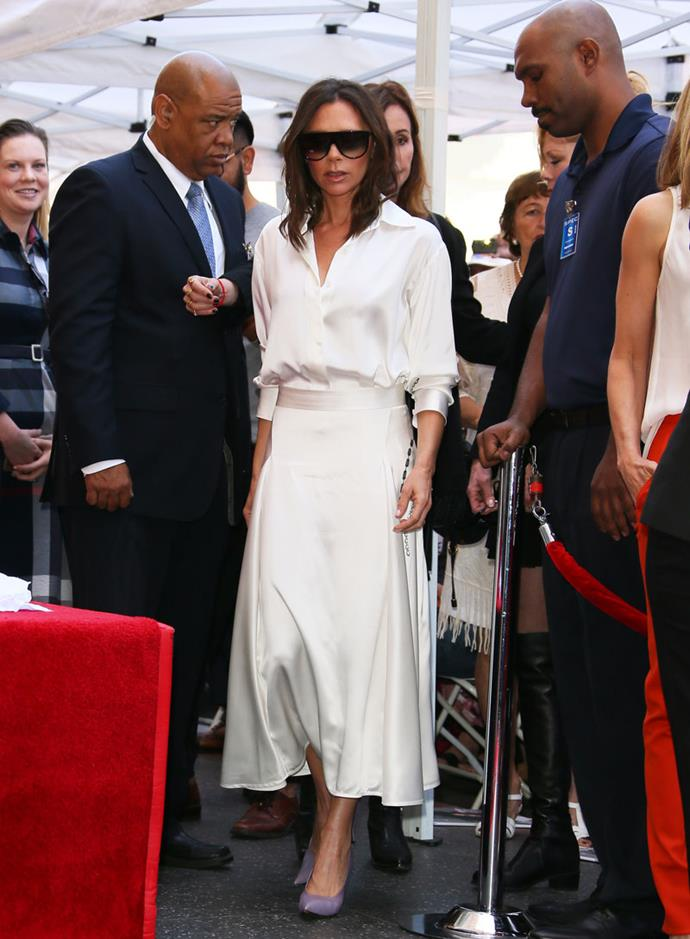 Victoria Beckham steps out on the Hollywood Walk of Fame wearing one of this season's biggest trends: white on white. Her silk ivory co-ordinates from her eponymous label perfectly demonstrates that, by pairing the shoes with violet pumps and her signature oversized shades.