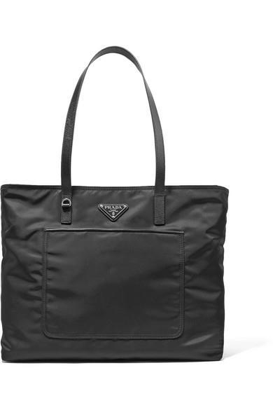 "**Prada 'Vela' Leather-Trimmed Messenger** <br><br> *$1370, [Net-a-Porter](https://www.net-a-porter.com/au/en/product/905084/Prada/vela-leather-trimmed-shell-tote|target=""_blank""|rel=""nofollow"")*"