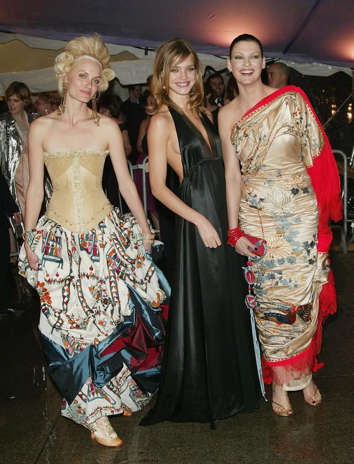 """**Amber Valletta in a Maggie Norris Couture corset and John Galliano skirt, Natalia Vodianova and Linda Evangelista in Jean Paul Gaultier Haute Couture**<br><br>  """"Amber Valletta's look teeters very close to Cosplay but it's just so *fashion*. I die."""" - Grace O'Neill, digital fashion editor"""