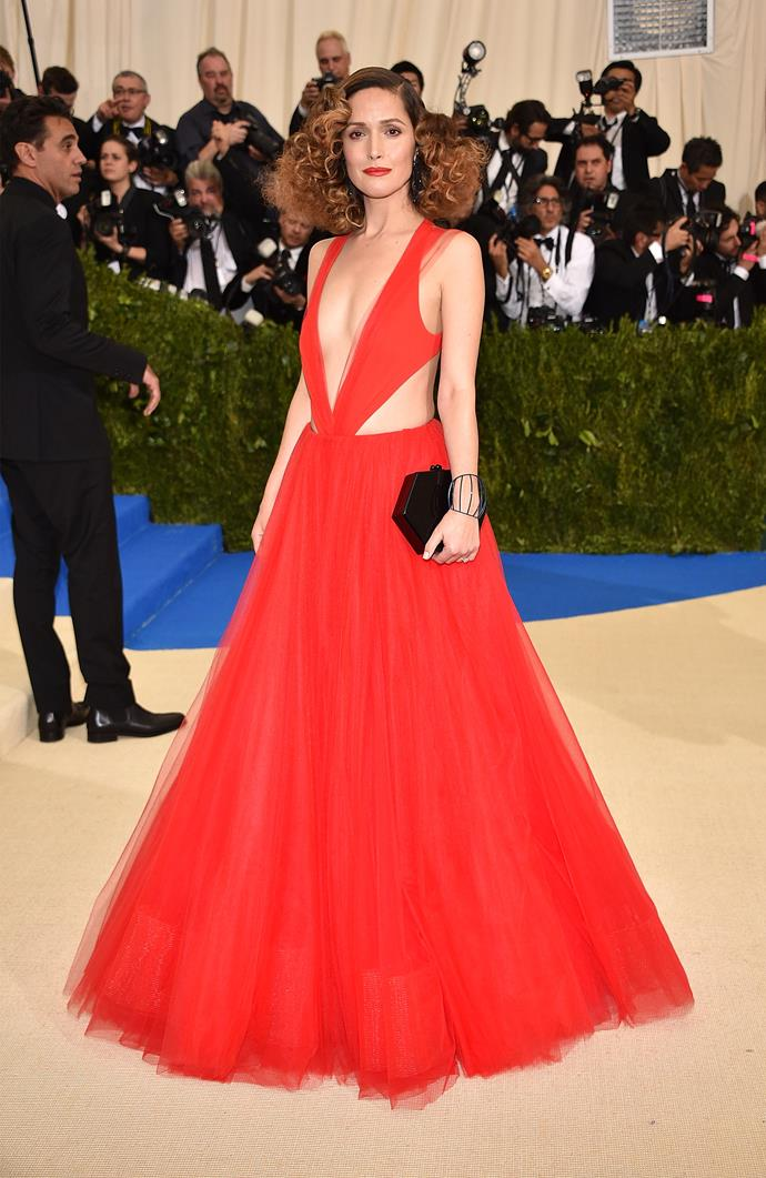 """**Rose Byrne in Ralph Lauren Collection** <br><br> """"Choosing a dress for the Met Gala must be tough. Not only do attendees need to look red carpet ready, they also have to adhere to an out-there theme. At the 2017 'Rei Kawakubo/Comme des Garcons: Art Of The In-Between' event, Rose Byrne nailed it."""" - Erin Cook, digital beauty editor"""