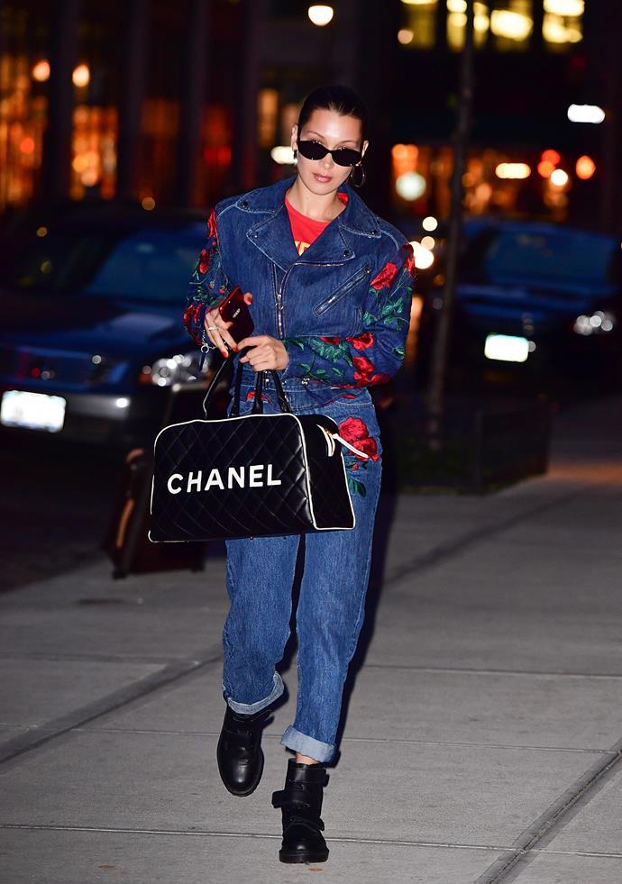 In New York City, wearing an Adam Selman denim suit and vintage Chanel handbag, April 23rd, 2017.