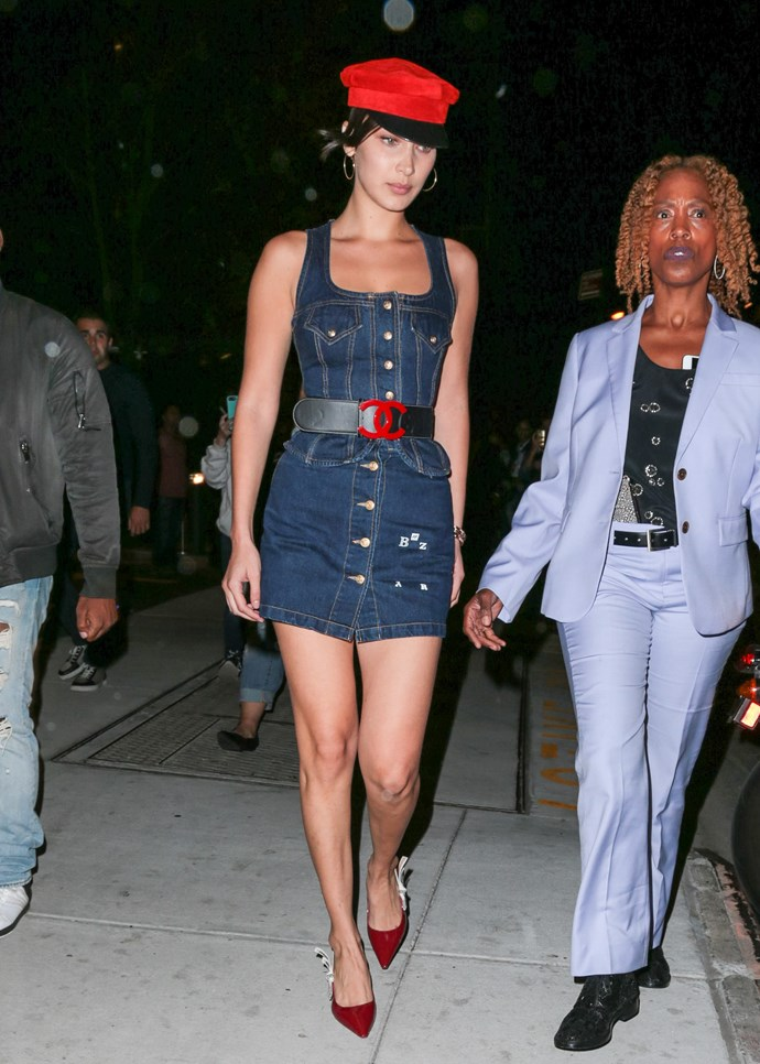 In New York City, wearing a denim mini-dress and vintage Chanel belt, September 8th, 2017.