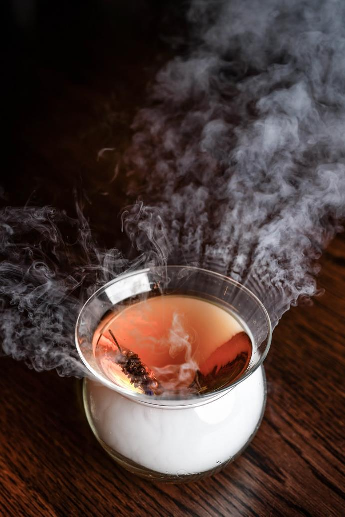 """**Sazerac Fog:** Made with bourbon, peychard biters, lavender syrup, absinthe wash and served with a smoked peat """"fog"""", and is available at [Eastside Kitchen + Bar](https://eastsidekitchen.com.au