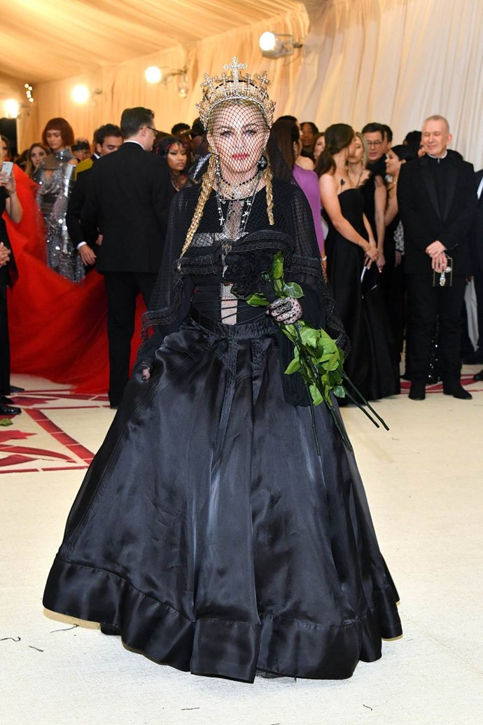 """**Madonna in Jean Paul Gaultier**<br><br>  """"Messing with Catholic motifs is Madonna's thing. She's got this. The crown, fishnet veil and bouquet of black roses are perfect touches, although arguably she'd nail this theme on an average Monday morning."""" - Tom Lazarus, chief subeditor"""