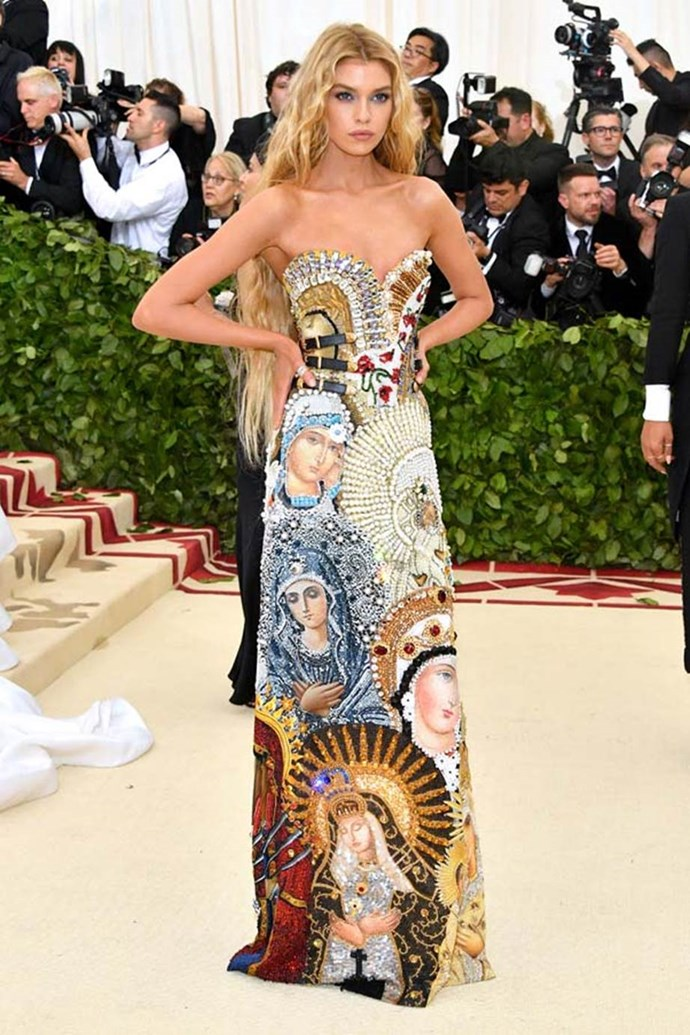"""**Stella Maxwell in Moschino**<br><br>  """"Stella Maxwell stylishly committed to this year's theme. The technicolour madonnas splashed across the skirt of her gown are toughened up with subtle leather straps around the waist, giving it a fashion-forward edge, before finished with Lady Godiva-worthy tresses."""" - Natasha Harding, digital fashion writer <br><br> """"Making a literal pitch for most iconic gown and daring us to argue."""" - Tom Lazarus, chief subeditor"""