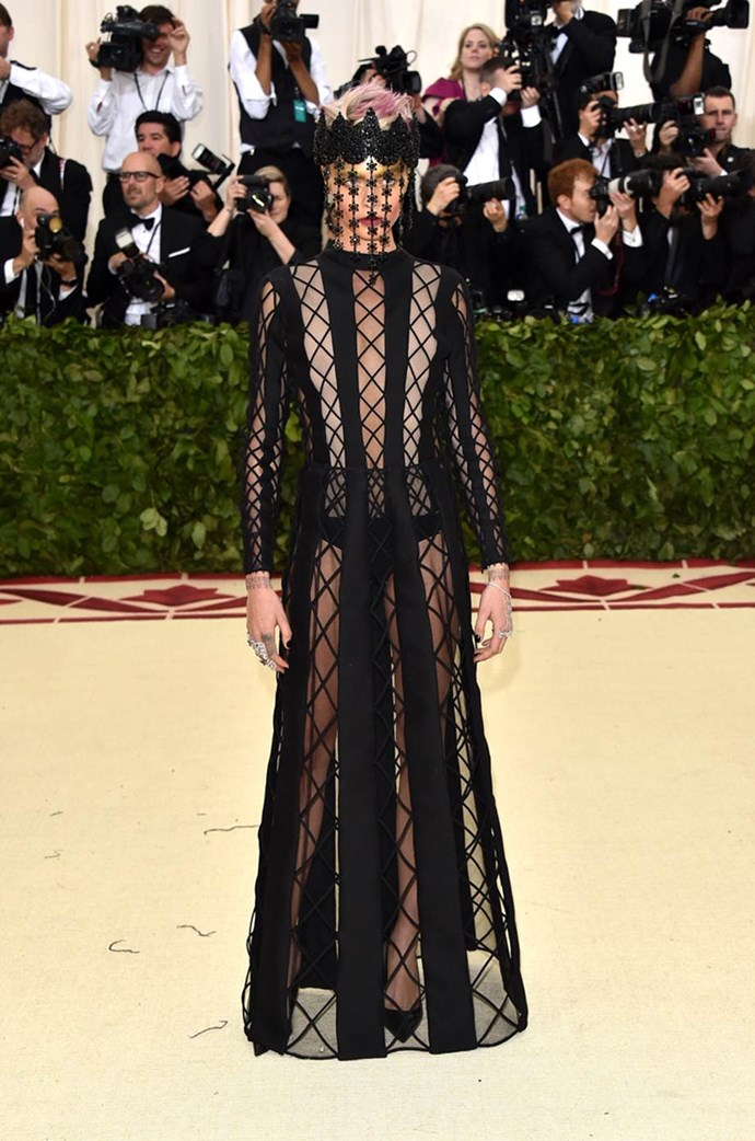 """**Cara Delevingne in Dior Couture** <br><br> """"Big tick to Cara Delevingne for being on theme but oh-so-cool in dramatic all-black Dior Haute Couture. And no Spanx in sight either! Also loved the neon pink hair popping out above the head piece."""" - Kellie Hush, editor-in-chief<br><br> """"Dior should totally move into the confession booth decorating business."""" - Jenna Clarke, digital managing editor"""