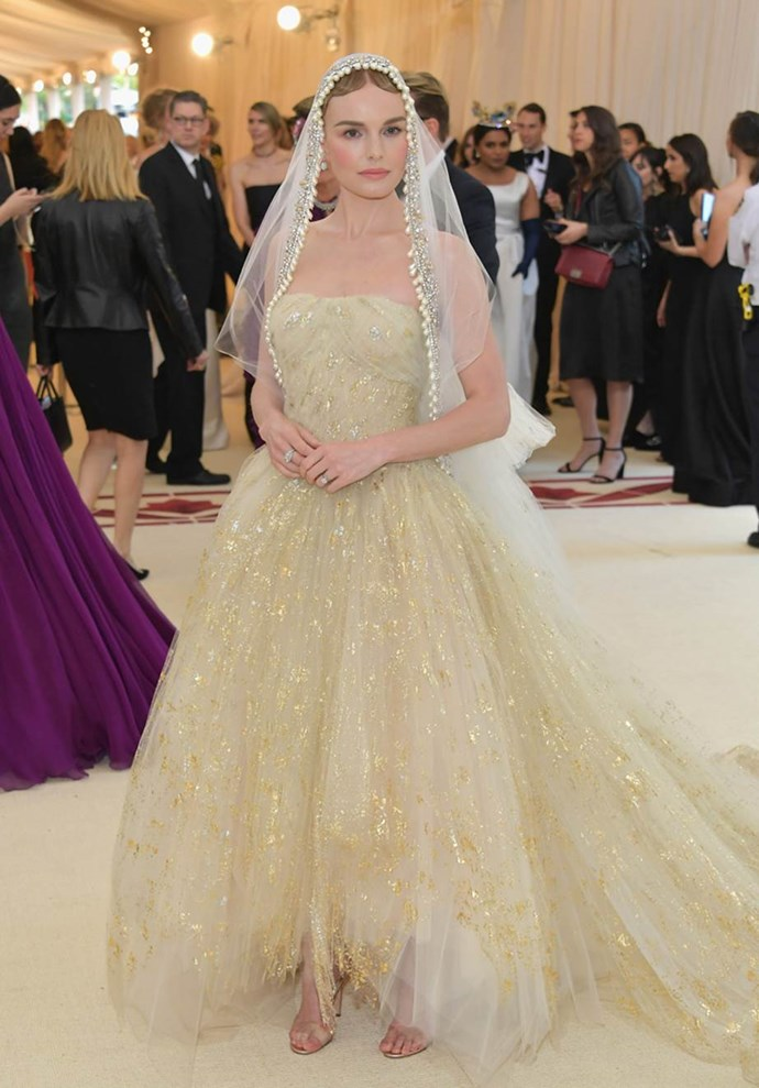 """**Kate Bosworth in Oscar de la Renta**<br><br>  """"She looks so beautiful in this Catholic bride look."""" - Caroline Tran, junior fashion editor<br><br>   """"Kate Bosworth absolutely stole the show when she took the steps of the Met looking like a virginal bride.  The paired back makeup, flowing tulle train and scalloped trim veil together are a match made in heaven."""" - Natasha Harding, digital fashion writer<br><br>  """"I'm completely in love with this look. From the nude minimal makeup to the on-trend PVC sandals."""" - Grace O'Neill, digital fashion editor"""