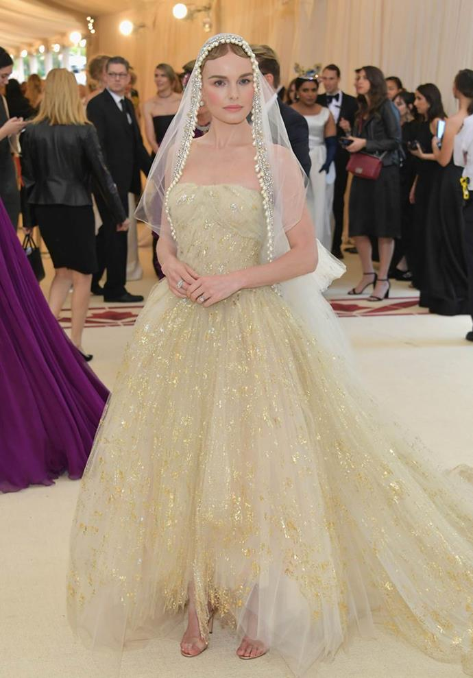 "**Kate Bosworth in Oscar de la Renta**<br><br>  ""She looks so beautiful in this Catholic bride look."" - Caroline Tran, junior fashion editor<br><br>   ""Kate Bosworth absolutely stole the show when she took the steps of the Met looking like a virginal bride.  The paired back makeup, flowing tulle train and scalloped trim veil together are a match made in heaven."" - Natasha Harding, digital fashion writer<br><br>  ""I'm completely in love with this look. From the nude minimal makeup to the on-trend PVC sandals."" - Grace O'Neill, digital fashion editor"