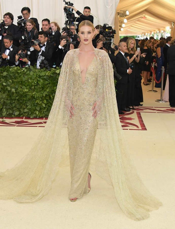 """**Rosie Huntington Whiteley in Ralph Lauren Collection**<br><br>  """"I'm putting RHW on my best dressed for her beauty look alone. A slick bun, mauvey-brown lips, gold eyes and a golden halo are all my fashion triggers. The glittering Ralph Lauren caped gown was just a bonus."""" - Mahalia Chang, digital features editor"""