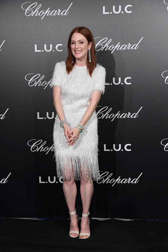 Later on May 9, Moore accessorised this ethereal white dress with Chopard jewellery at a Chopard event.