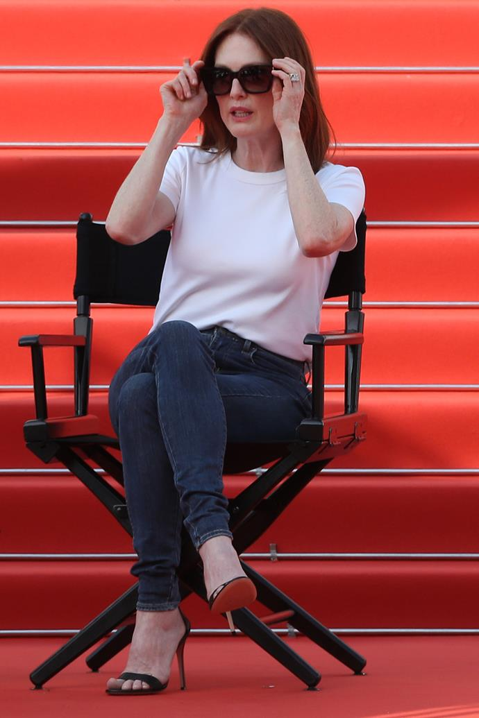 At a promotional event, Moore donned a plain white t-shirt and jeans with open-toe heels.
