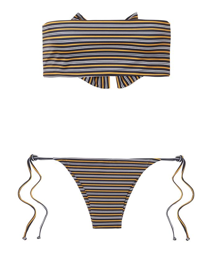 "The oversized bow at the back adds a playful edge to this bandeau bikini. <br><br> [Faithful The Brand bikini](https://www.net-a-porter.com/au/en/product/1050559/faithfull_the_brand/striped-bandeau-bikini|target=""_blank""