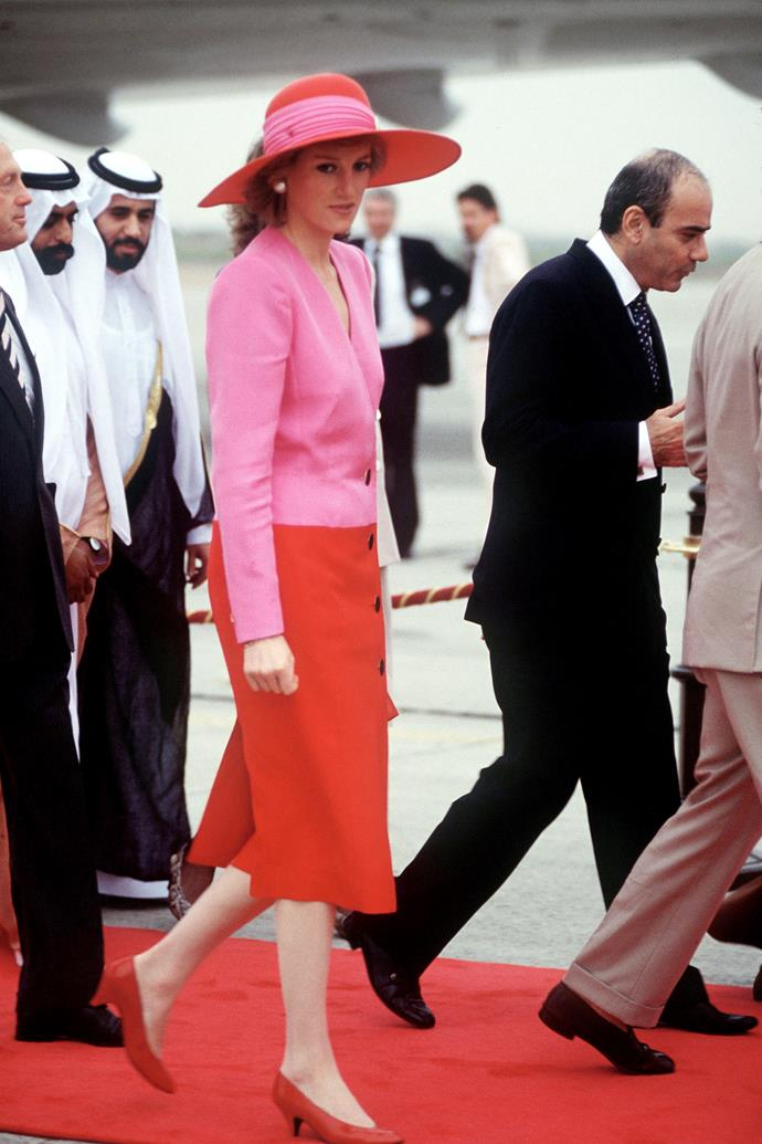 **PRINCESS DIANA IN KUWAIT: 1988** <br><br> Diana won fashion hearts around the world with this scarlet and fuschia ensemble (featuring a Philip Treacy hat) on the same Middle East tour.
