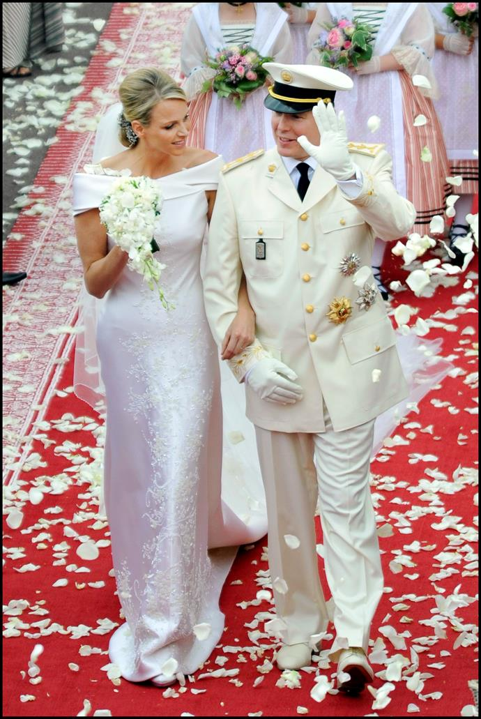 **Charlene, Princess of Monaco**  Married: The then Charlene Wittstock married Albert II, Prince of Monaco  Designer: Custom Giorgio Armani.   Estimated Cost: The off-white silk duchess satin gown was embroidered with Swarovksi crystals and mother of pearl on the front and back. It took 2500-hours to create.