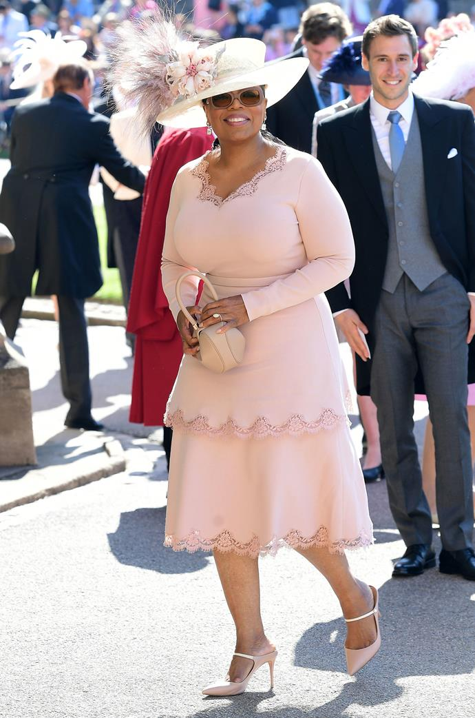 Oprah Winfrey in a Gabriela Hearst handbag and Malone Souliers shoes