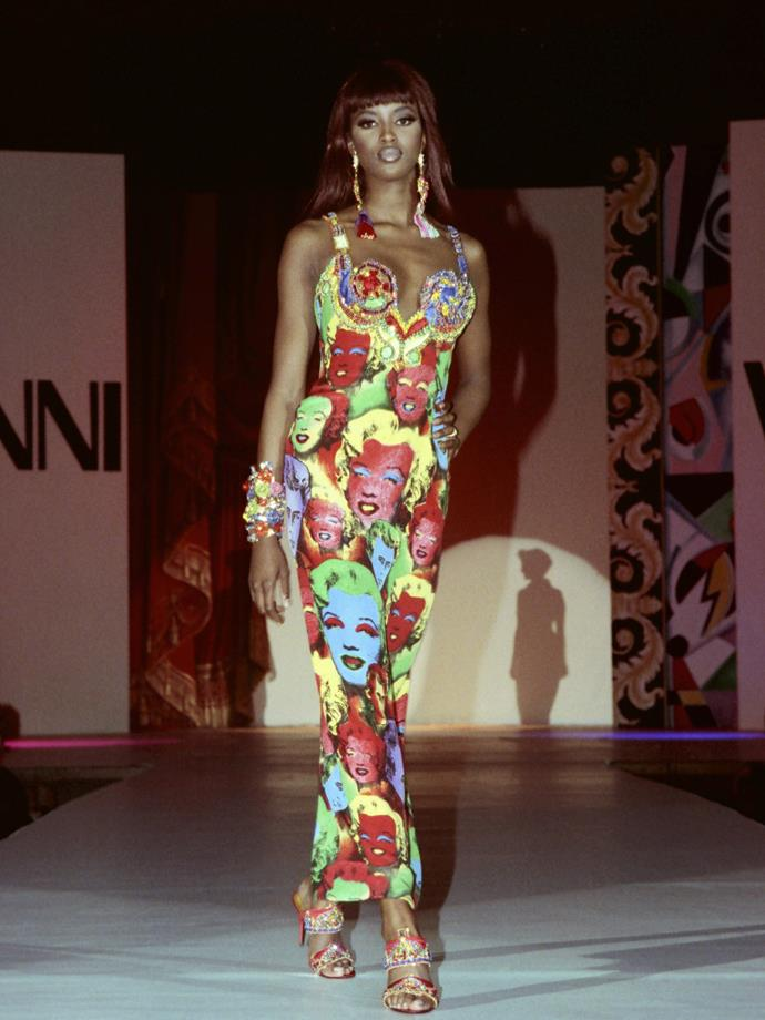 Walking for Versace in 1991, modelling the famous Marilyn Monroe-print dress.