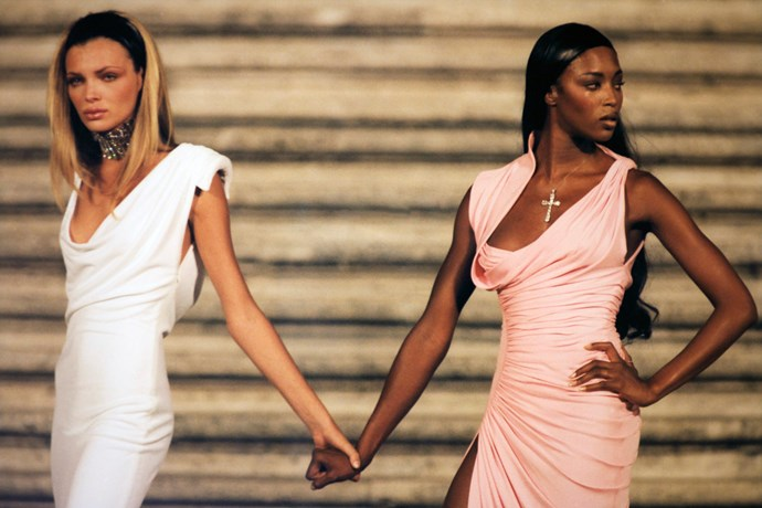 Naomi and Ester Cañadas walking for Versace in 1997, in the first show after Gianni Versace's murder.