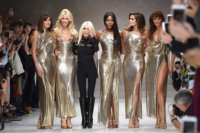 Walking for Versace spring/summer '18 with Donatella Versace and original supermodels Carla Bruni, Claudia Schiffer, Cindy Crawford and Helena Christensen, in a tribute to Gianni Versace.