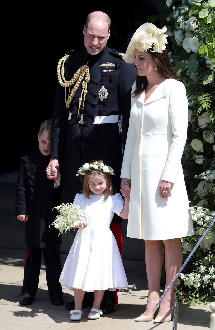 Kate Middleton in Alexander McQueen at the royal wedding, with Prince William, Prince George and Princess Charlotte.