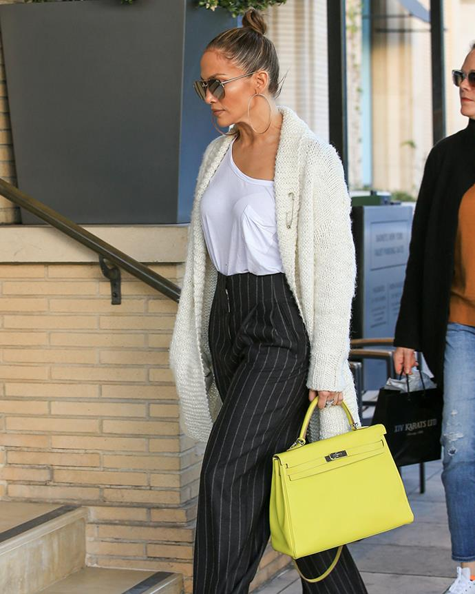 With a neon yellow Hermès Kelly bag in Los Angeles on 28 December, 2016