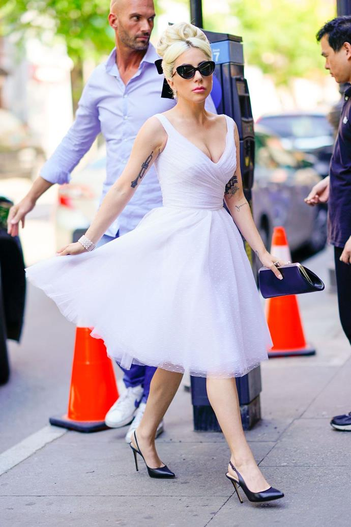 **May 24**:  <br><br> Going for an ultra-ladylike, ballerina-inspired look, Gaga stepped out in a white tulle dress, black cat-eye sunglasses, and black Neil J. Rodgers slingback pumps on Thursday.