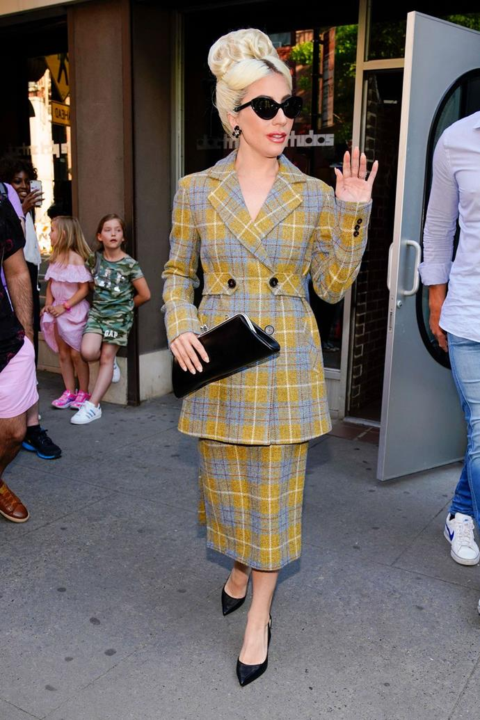 **May 24:**  <br><br>  Later in the day, she emerged in a Cher Horowitz-meets-Working-Girl-inspired outfit. Once again, she topped off the look with cat-eye-sunglasses, a clutch, and Neil J. Rodgers pumps.