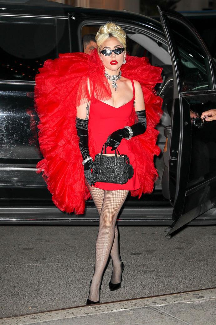 **May 24:**   <br><br> Oh, this old thing? That night, Gaga went full-on showgirl in this red tulle Christian Siriano look, black satin opera gloves, diamond jewellery, and retro cat-eye sunglasses for a totally casual dinner out in New York. Iconic.