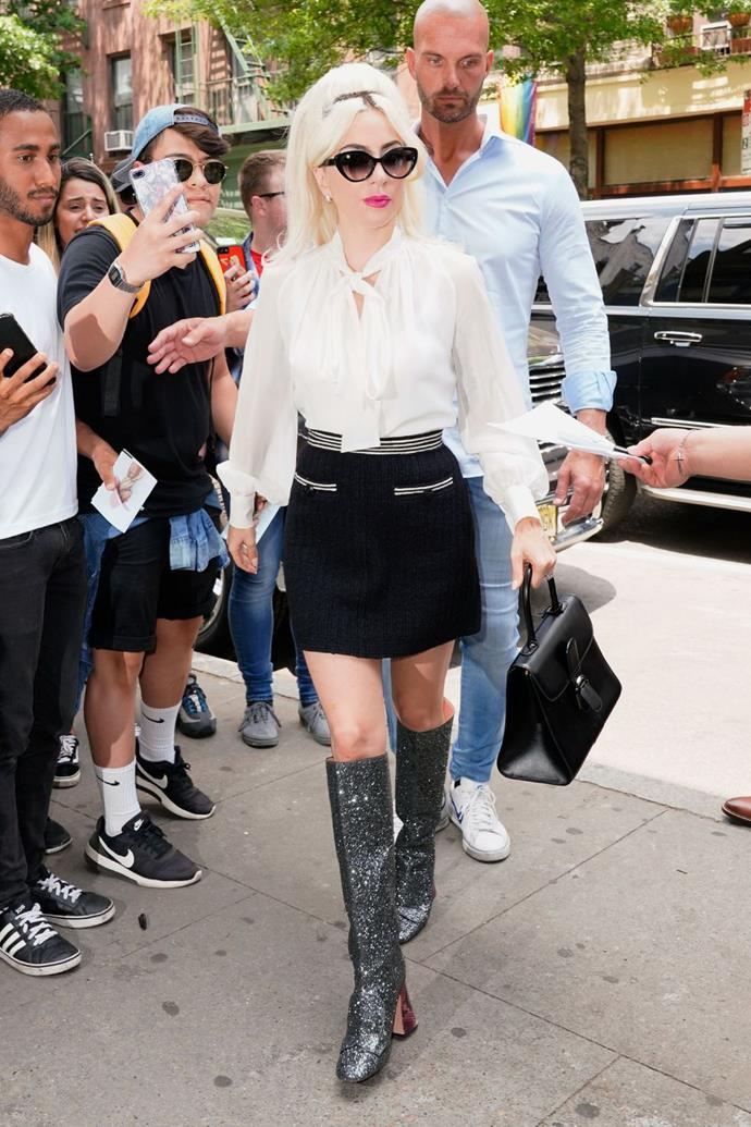 **May 26:**  <br><br> Adding an unexpected splash of fun to her classic white blouse and black mini skirt, the singer opted for a pair of sparkling Rochas glitter boots that lended a playful go-go girl vibe to her look.