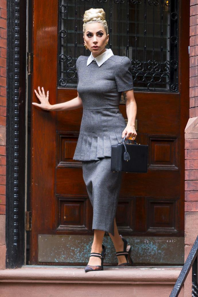 **May 27:**   <br><br> ...but then she went back to the elegant look with a Peter Pan collared dress, a Mark Cross bag, and pointed pumps later that day.
