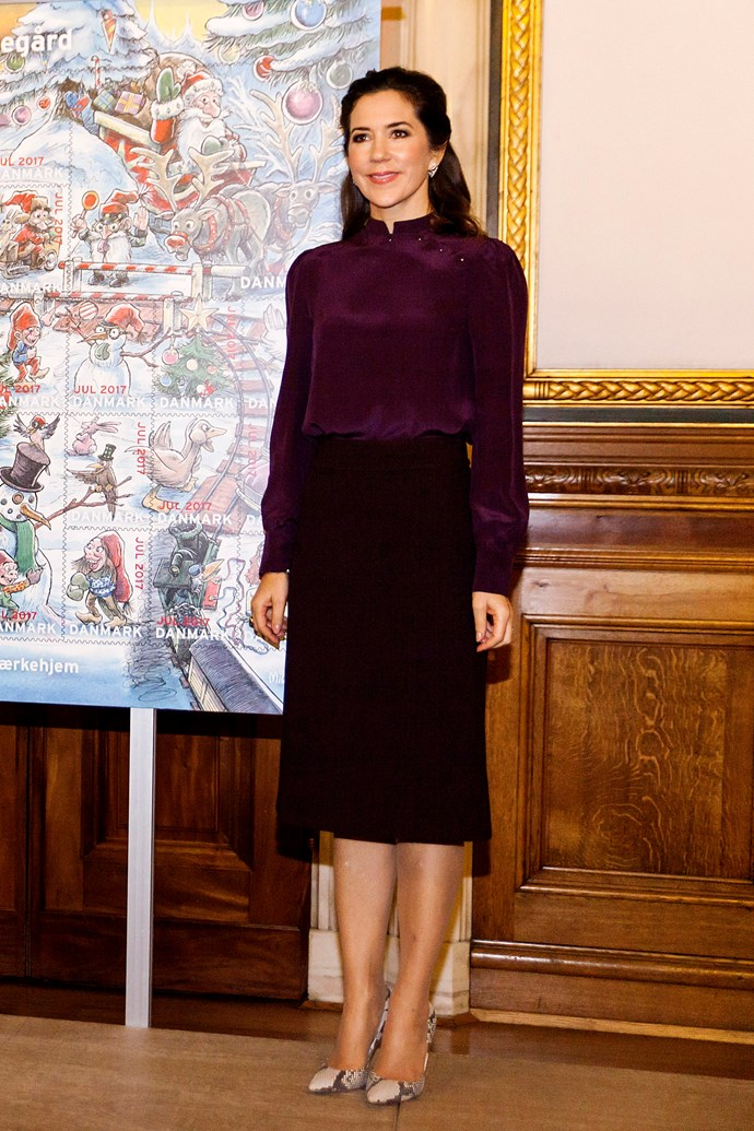 **November 3, 2017** <br><br> Mary wore a dark maroon blouse and coordinating skirt with python pumps at a charity event in Copenhagen.