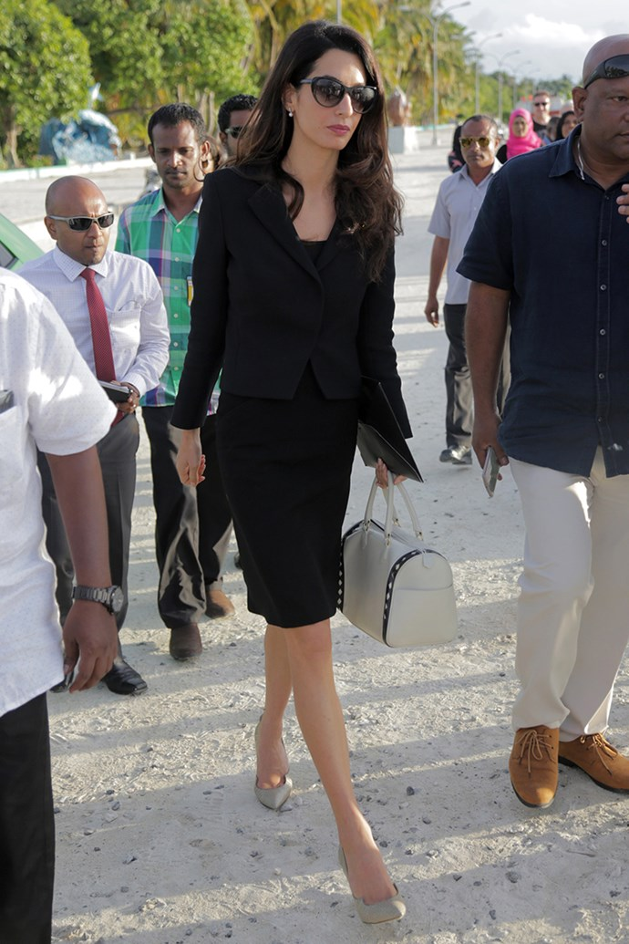 Wearing a black pencil skirt suit and Paul Andrews pumps in the Maldives on September 8, 2015