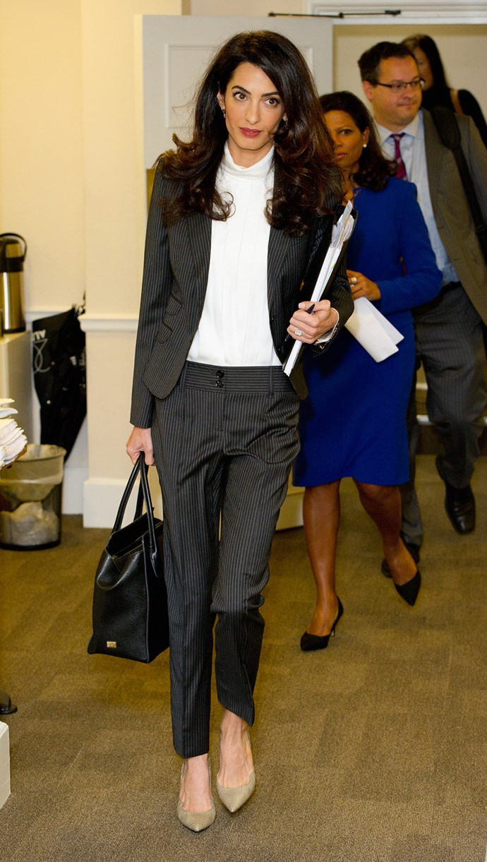 Wearing a Dolce & Gabbana suit and bag in London on October 5, 2015