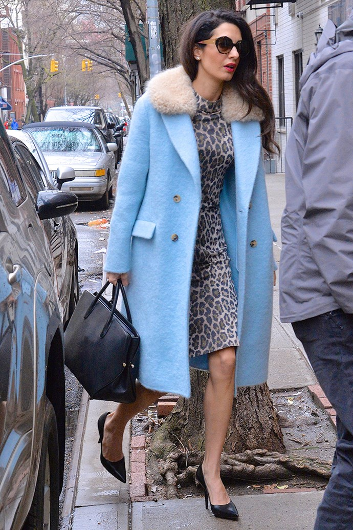 Wearing a sky blue Ermanno Scervino coat, Dior handbag and Givenchy heels in New York City on April 6, 2018