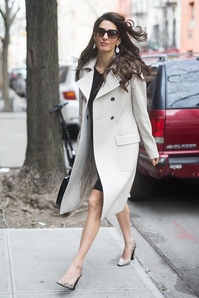 Wearing a taupe overcoat and snakeskin heels in New York City on April 9, 2018