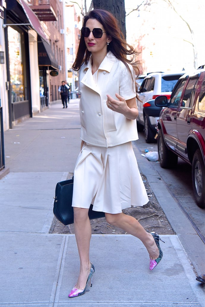 Wearing an ivory skirt suit and Off-White x Jimmy Choo pumps in New York City on April 13, 2018