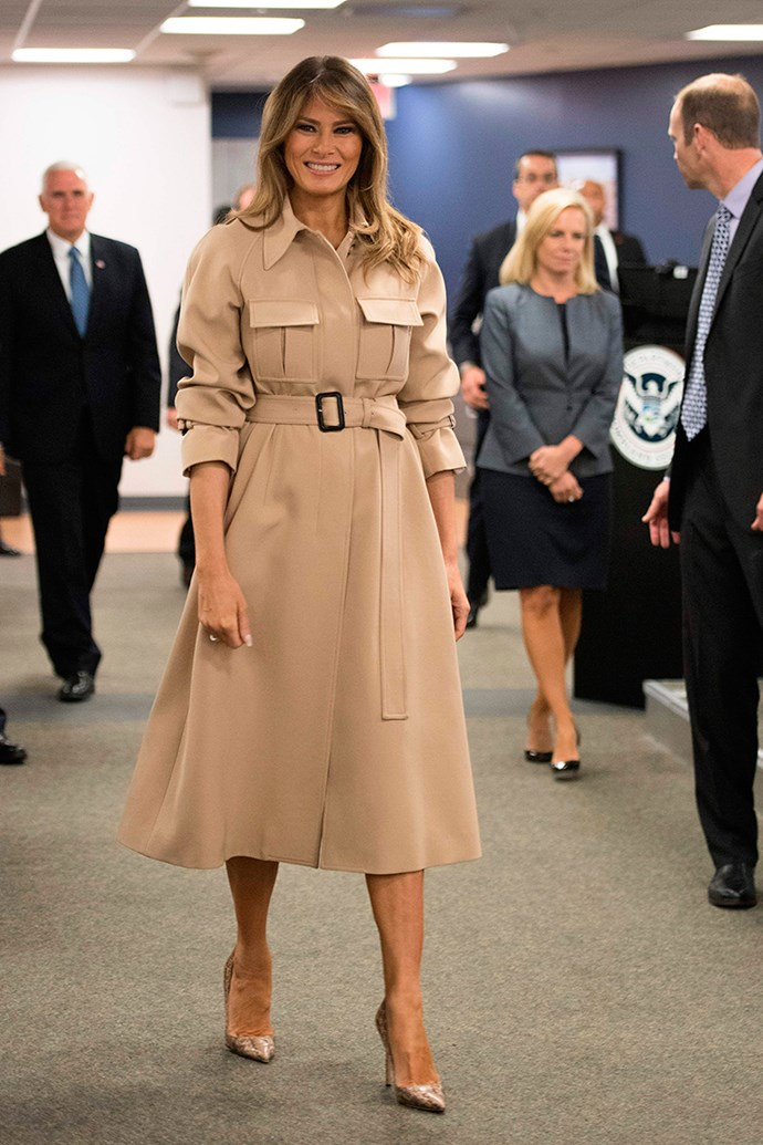 Melania Trump just made her first public appearance in a month following growing concerns for the First Lady's health. Melania underwent a kidney procedure, which involved the FLOTUS being hospitalised for a week. But you would never guess it, with Melania attending the 2018 Hurricane Briefing in Washington DC looking absolutely flawless. The First Lady reinvented her signature coat-dress uniform, this time in a rich caramel hue, complete with pockets and a pair of matching snakeskin pumps.