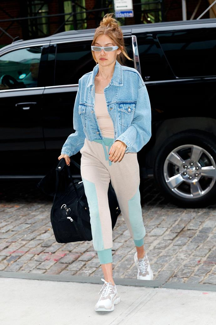 Wearing oatmeal co-ordinates with Tiffany blue accents, dad sneakers and tiny sunglasses in New York City on 18 June, 2018