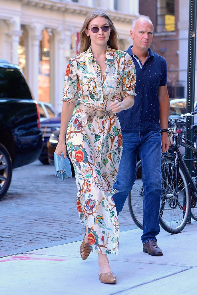 "Wearing a floral Alberta Ferretti maxi dress and $230 Freda Salvador [crocodile-inspired mules](https://www.fredasalvador.com/collections/mules/products/lay-toffee-embossed-croc|target=""_blank""